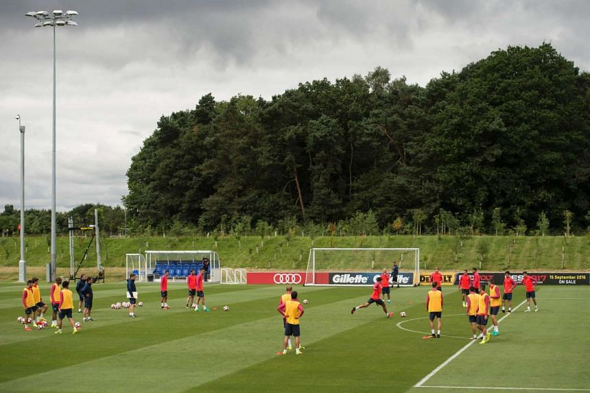 Barcelona FC's players take part in a team training session at St George's Park near Burton-on-Trent, central England, on July 29.