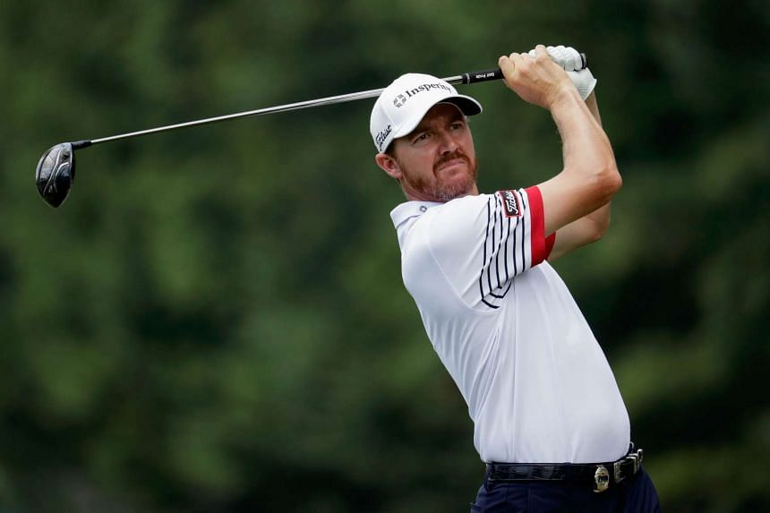 Jimmy Walker of the United States plays his shot from the sixth tee during the second round.