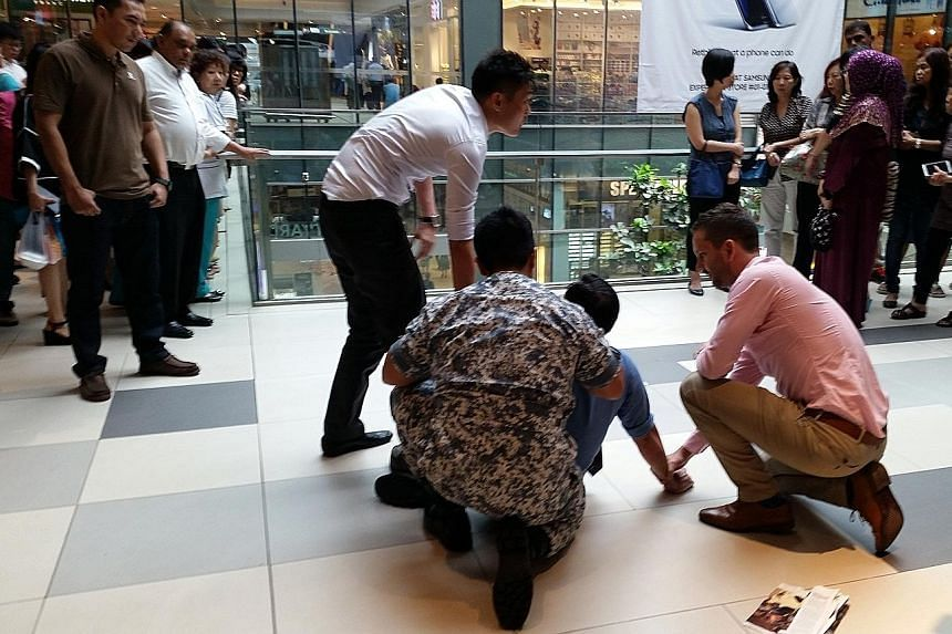 A 49-year-old man being held down by passers-by at Westgate after being spotted allegedly taking upskirt shots of a woman on an escalator at the neighbouring Jem mall.