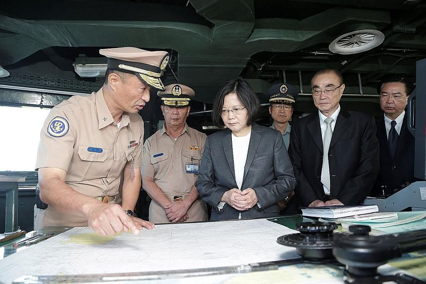 President Tsai Ing-wen with naval officials. Taiwan's military personnel are covered by the public service pension fund, which provides pensions of up to 100 per cent of last-drawn salary.