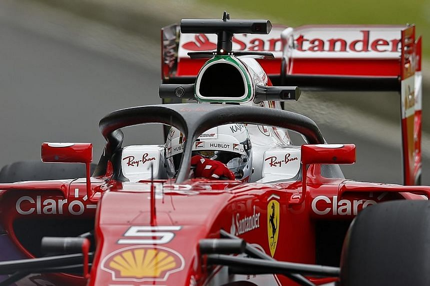 Sebastian Vettel practising with a Ferrari fitted with the halo before this month's British Grand Prix. The head protection device remains a subject of debate among the F1 drivers.