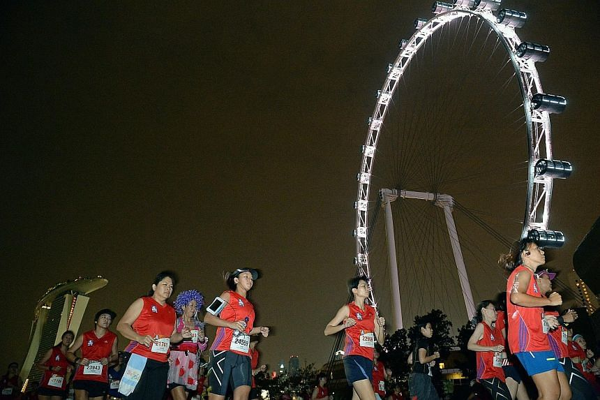 Great Eastern Women's Run participants running past the Singapore Flyer in last year's event, which won the Best Local Sports Event of the Year (Local) at this year's Singapore Sports Awards.