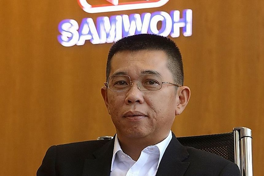 Mr Eric Soh (above), Samwoh Corporation chief executive and one of the defendants, said he was pleased with the verdict. The company (right) was founded in 1975 as Samwoh Transport and Trading by three friends.