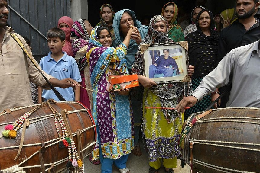 Relatives of Zulfiqar Ali celebrating in Lahore, Pakistan, yesterday after Indonesia halted the Pakistani national's execution. Ali was sentenced to death in 2005 for heroin possession.
