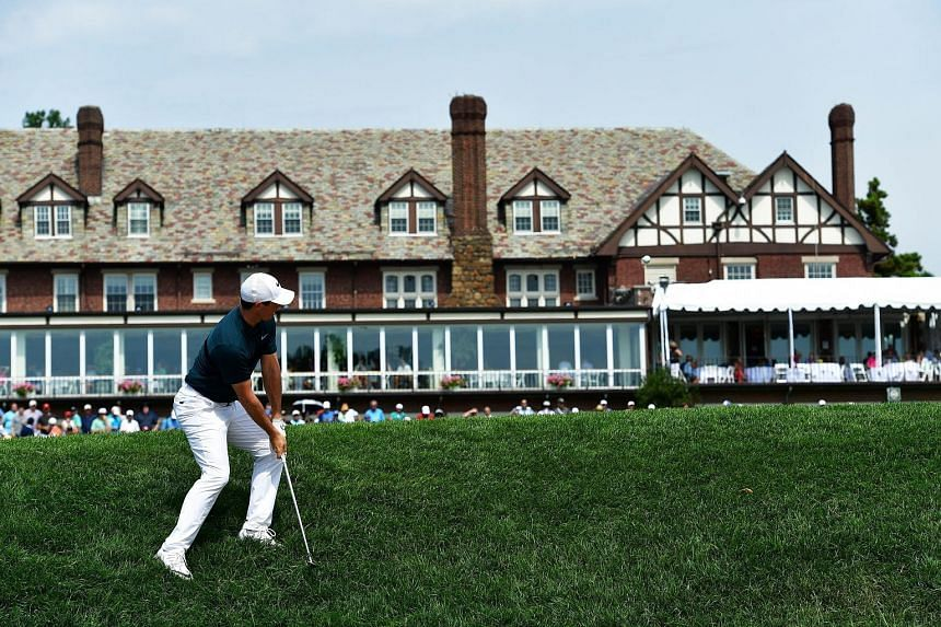 Rory McIlroy taking his approach shot on the 18th hole in the first round. He struggled on the greens at Baltusrol most of the time.