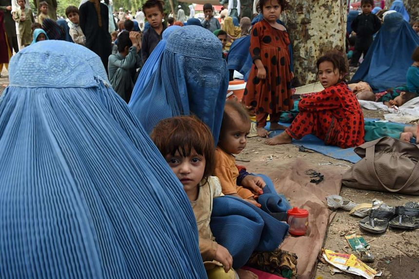 Afghan refugee women and children in Peshawar, Pakistan, on July 14, 2016.