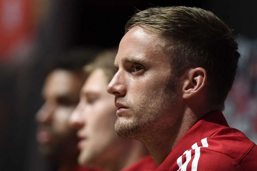 Wales' midfielder Andy King has signed a new four-year contract with Leicester City.