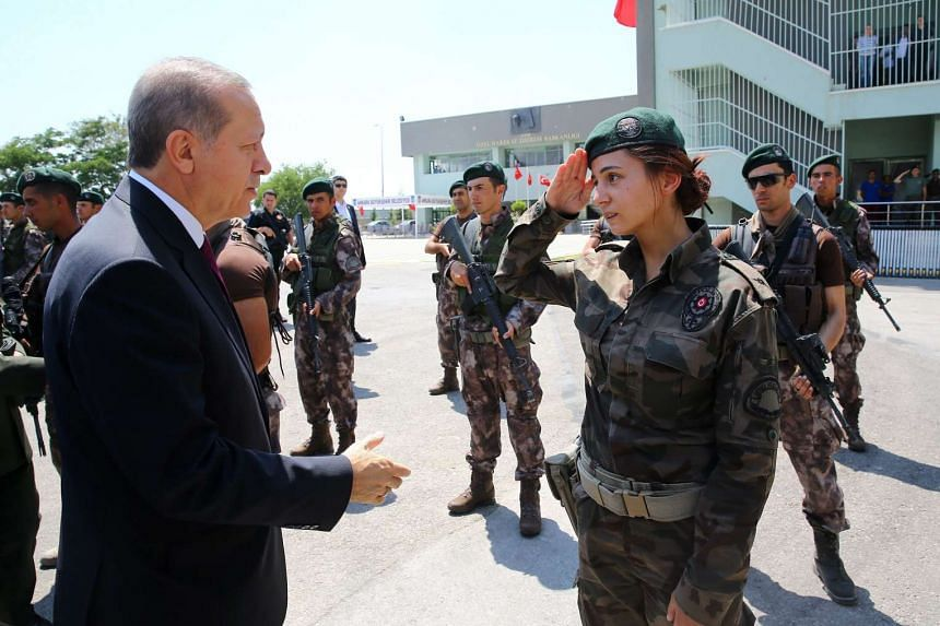 Erdogan (left) visiting the Turkish police special forces headquarters, in Ankara, Turkey, on July 29,  2016.