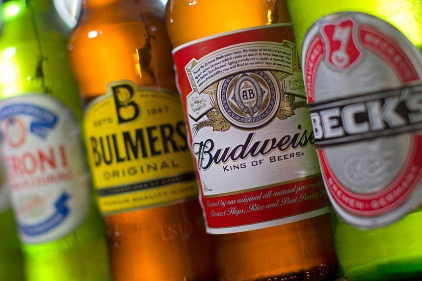 Bottles of beer and cider produced by Belgian-Brazilian group Anheuser-Busch InBev and British brewer SABMiller.
