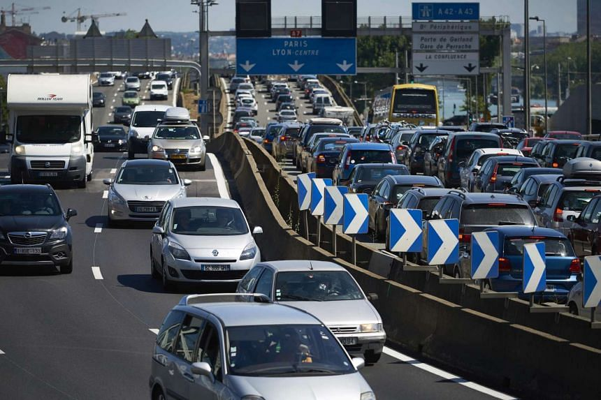 Motorists driving in a traffic jam on the A7 motorway near Lyon, during French summer holidays.