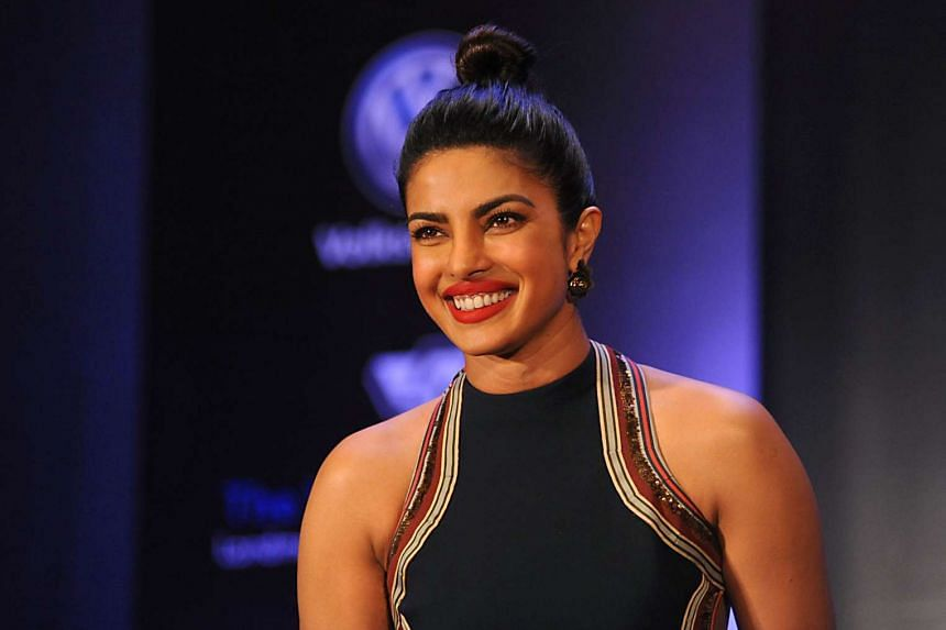 Indian Bollywood actress Priyanka Chopra poses during a promotional event for Maxim India in Mumbai on June 30, 2016.