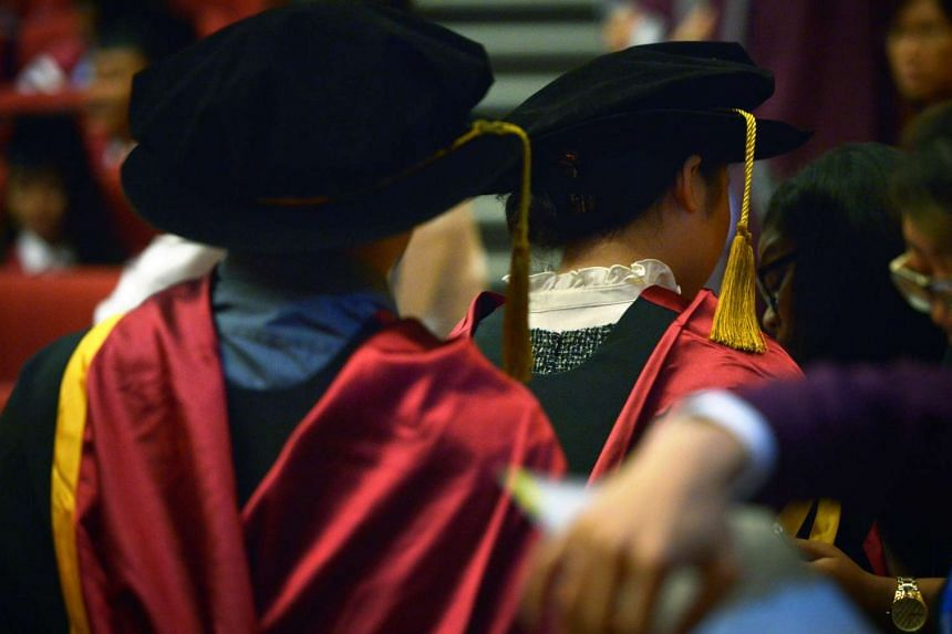 Graduates from NTU during a Commencement ceremony.