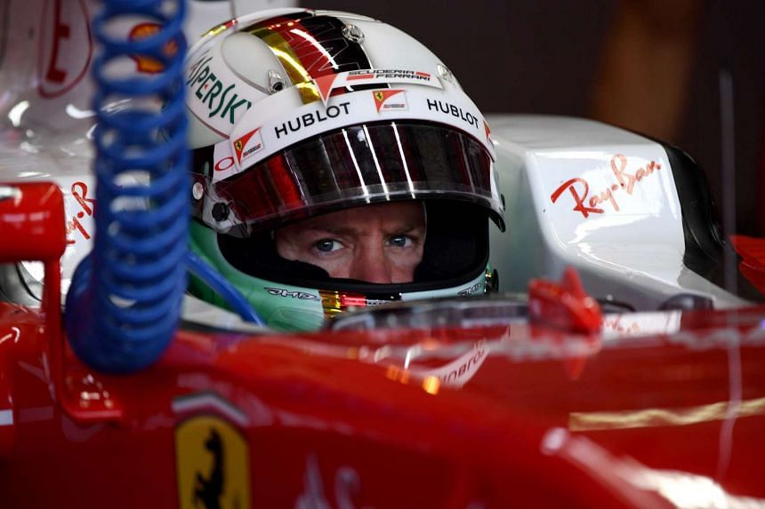 Ferrari's German driver Sebastian Vettel gets ready for the first practise session of the German Grand Prix on July 29, 2016.