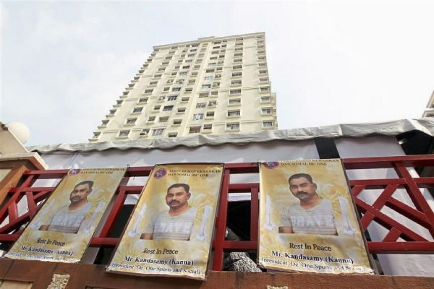 Buntings with slain moneylender V. Kandasamy's portrait plastered at his residence in Setapak.