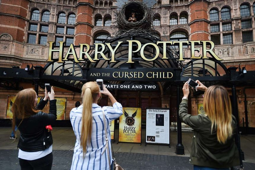 Harry Potter fans photograph the Palace Theatre in London on July 29, 2016.