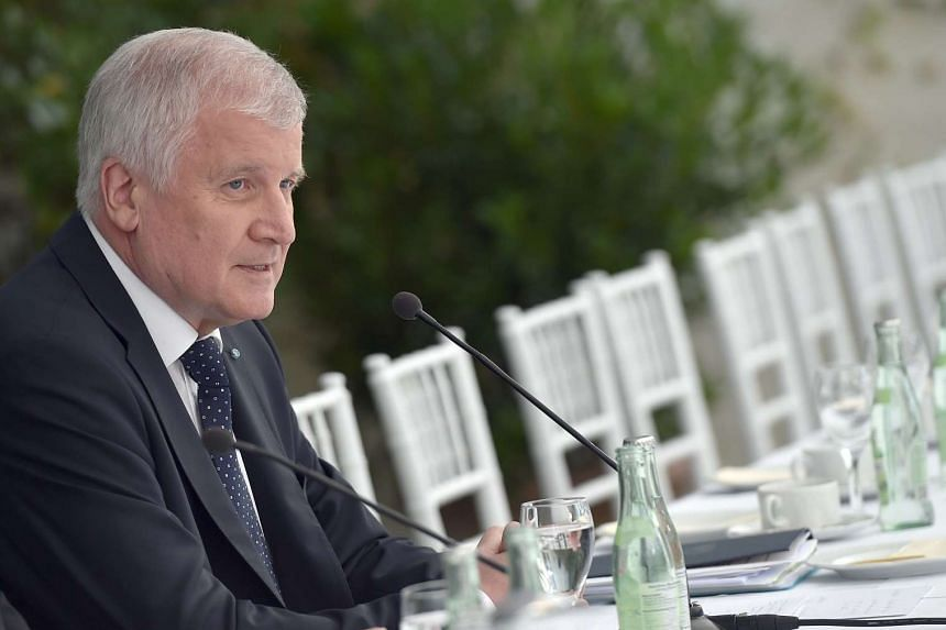 Bavaria's State Premier Horst Seehofer gives a press conference on July 30, 2016 in Gmund, southern Germany.