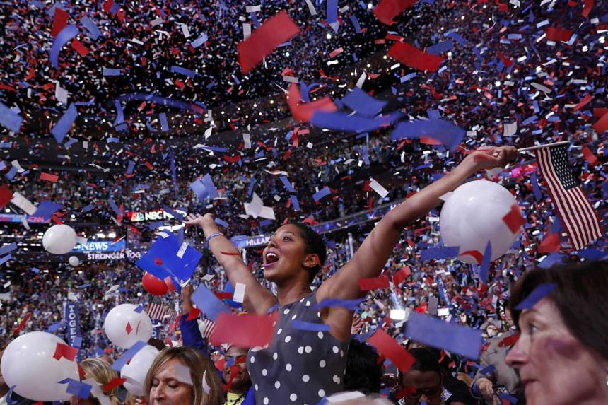The crowd celebrating amid confetti and balloons after Mrs Clinton accepted the presidential nomination at the Democratic National Convention in Philadelphia. Analysts say she had differentiated herself from Mr Trump, addressed the more rebellious wi