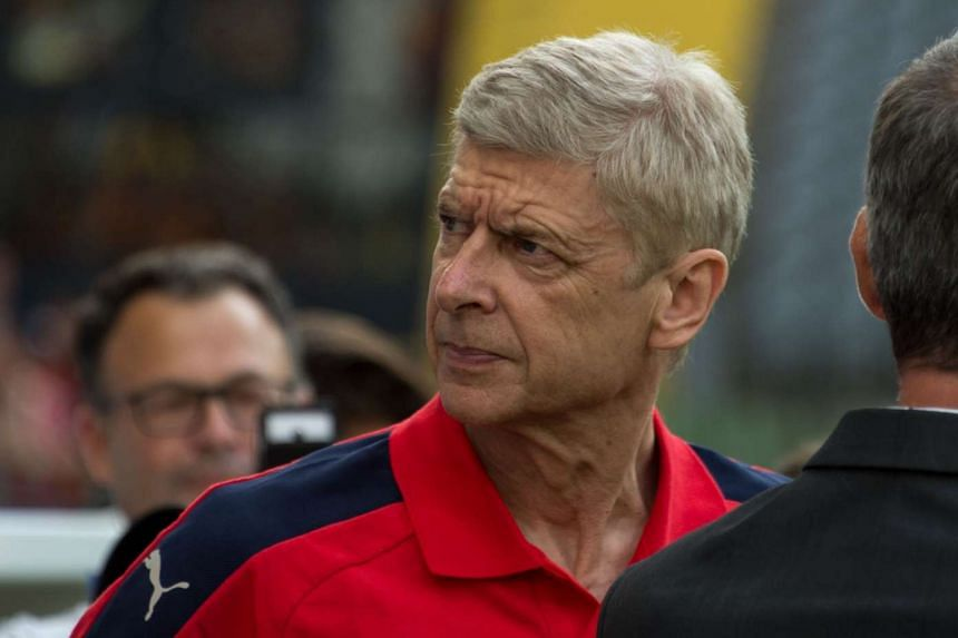 """Wenger (above) described the money being spent on players recently as """"scary""""."""