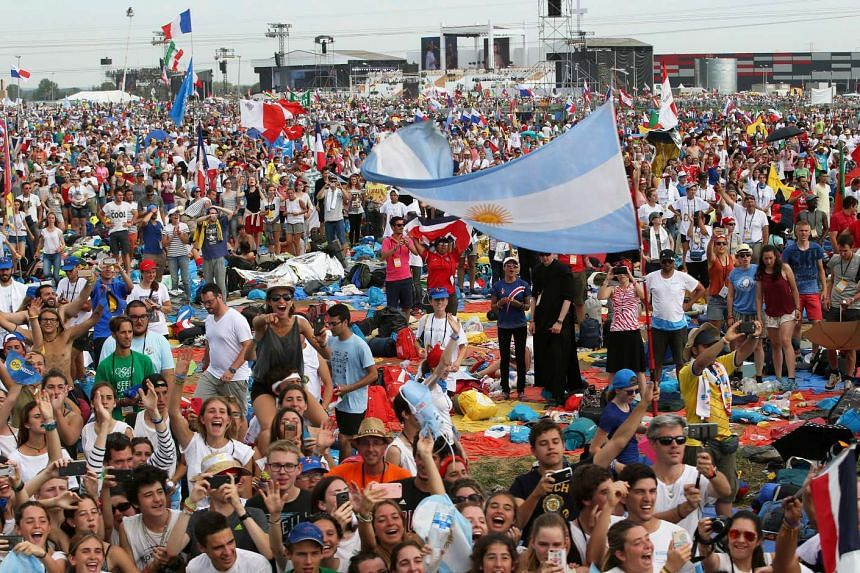 A youth waves an Argentina flag as Pope Francis arrives to the Campus Misericordiae during World Youth Day in Brzegi near Krakow, Poland on July 31, 2016.