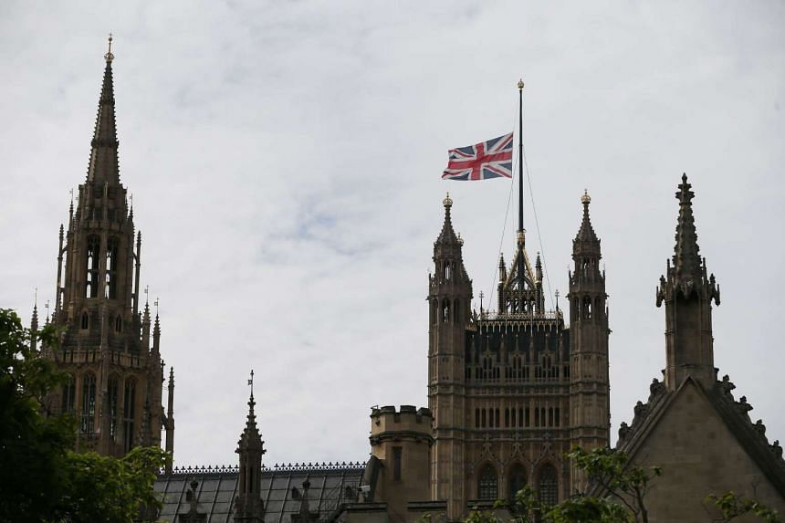 Union Flags fly at half-mast above the Houses of Parliament in central London on July 15, 2016 in honour and solidarity with the victims of the deadly attack in Nice.