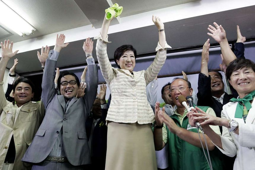 Japan's Former Defense Minister Yuriko Koike celebrates her victory in the Tokyo Gubernatorial Election after being elected as the governor of Tokyo at her election campaign office on July 31, 2016.
