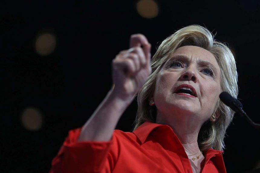 Hillary Clinton has accused Russian intelligence services of hacking into Democratic National Committee computers.