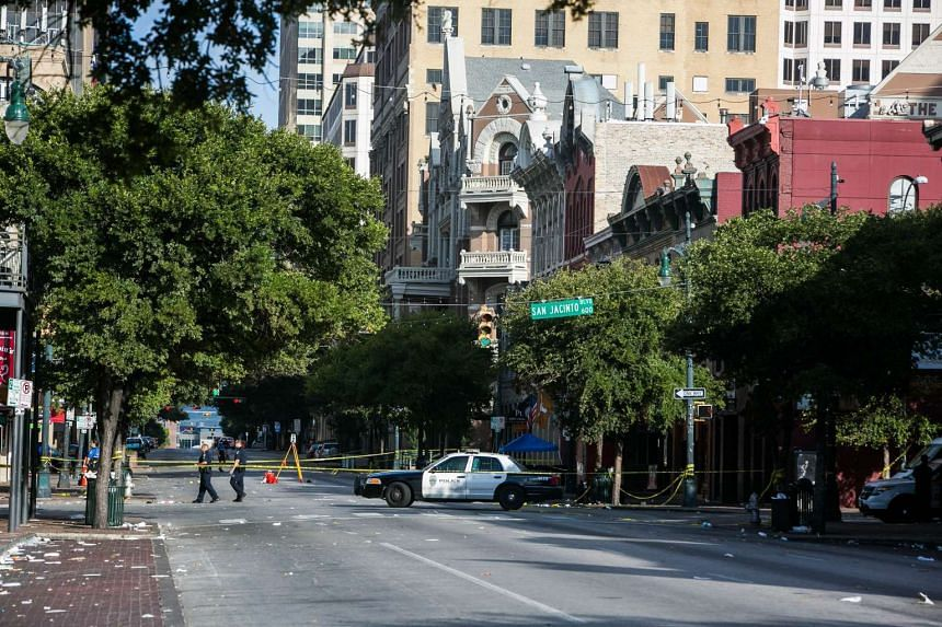 Police block off an area of 6th Street after two shootings July 31, 2016 in downtown Austin, Texas.