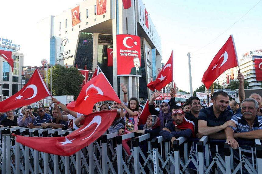 Pro-Erdogan supporters gather during a rally against the military coup at Kizilay Square in Ankara, on July 25.