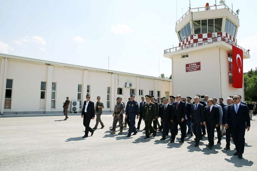 Turkish President Recep Tayyip Erdogan (fourth from right), during a visit to the Turkish police special forces headquarters, in Ankara on July 29, 2016.