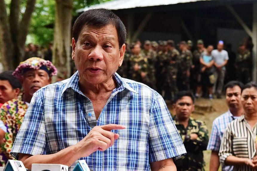 Philippine President Rodrigo Duterte speaks to members of the media during a visit to a military camp in Asuncion town, Davao del Norte province in this photo released on July 30, 2016.