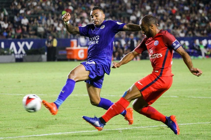 Leicester City defender Danny Simpson (left) and Paris Saint-Germain midfielder Lucas Moura (right) battle for the ball during their International Champions Cup (ICC) football game at StubHub Center in Carson, California on July 30, 2016.