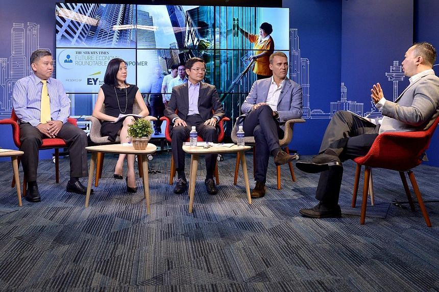 At the roundtable discussion earlier this month were (from left) Senior Manpower Correspondent Toh Yong Chuan; EY partner and Asean People Advisory Leader Dilys Boey; Workforce Development Agency CEO Ng Cher Pong; LinkedIn managing director and vice-