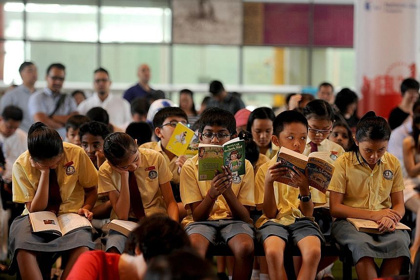Pupils from Da Qiao Primary School at the National Library Building yesterday taking part in the Read For Books campaign, which sees one book donated to less privileged children for every 10 people who read for 15 minutes.