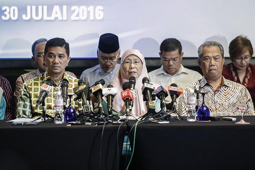 Former DPM Mr Muhyiddin (at right) with PKR president Dr Wan Azizah (centre) and other party leaders at a media conference yesterday. Mr Muhyiddin said the PKR would hold meetings in rural areas, where the bulk of support for the ruling Umno coalitio