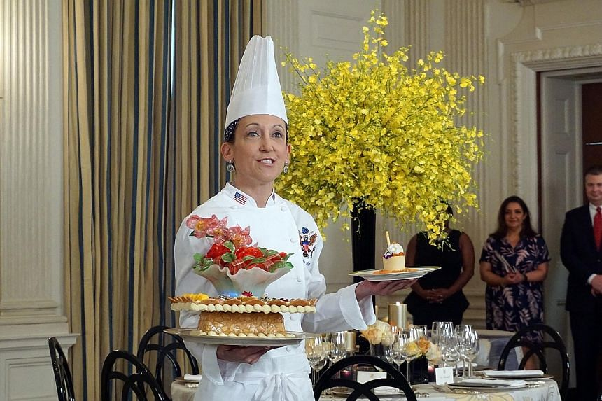 """Executive pastry chef Susie Morrison with her desserts for the state dinner. Called """"A Festive Gathering"""", the desserts have a motif of orchids and roses."""