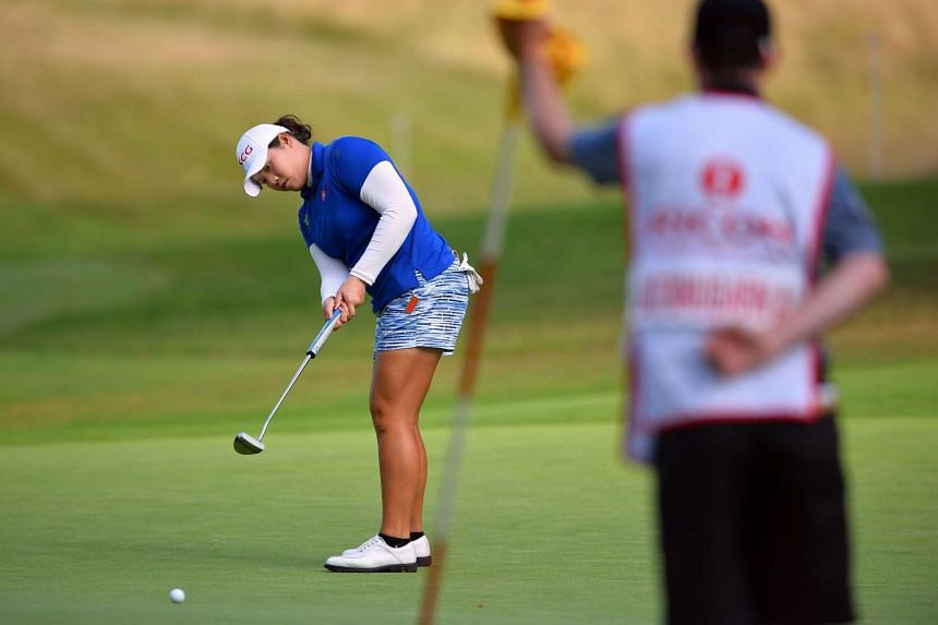 Thailand's Ariya Jutanugarn putts on the 17th green on the third day of the British Open.
