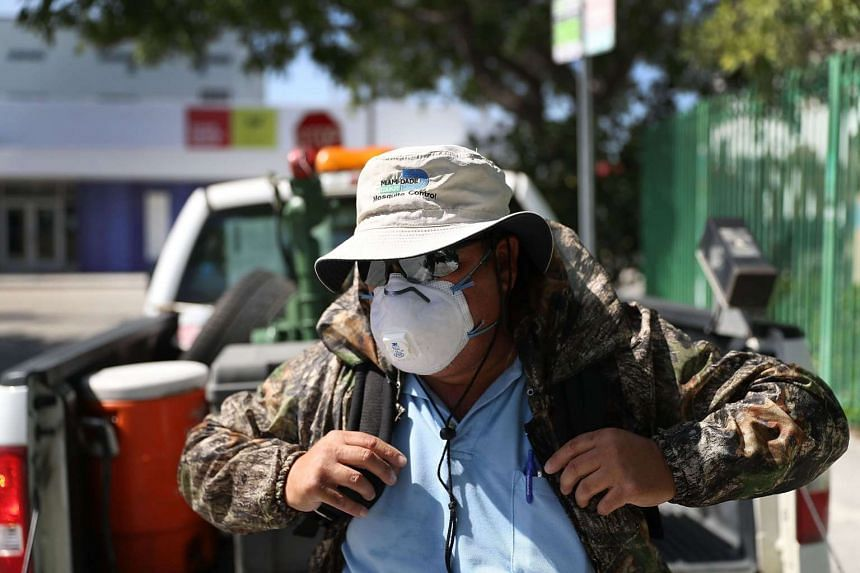 A mosquito control inspector prepares to use a fogger to kill mosquitos in Miami, Florida, on July 30, 2016.
