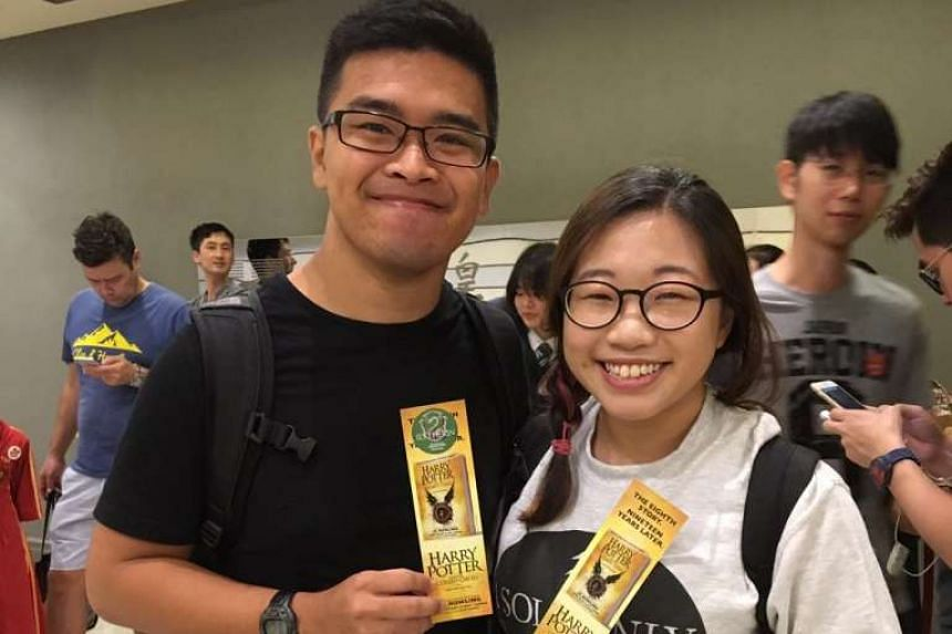 Undergraduates Samantha Chua, 24, and Jeremy Liu, 25, were first in line at Kinokuniya, Ngee Ann City. They were there since 5am.