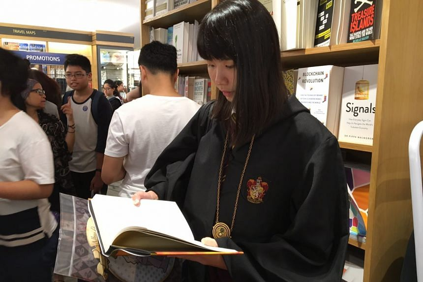 Mavis Tan, 24, reading the book the moment she got her hands on it.