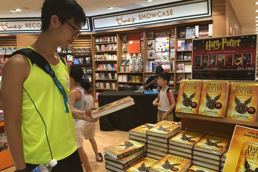 Chong Koh You, 34, popped by the Times outlet in Waterway Point after a run to buy the script book.