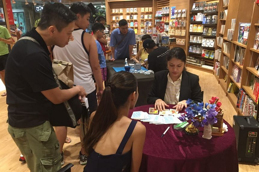 Tarot card reading during the release of Harry Potter and The Cursed Child at Times, Waterway Point.