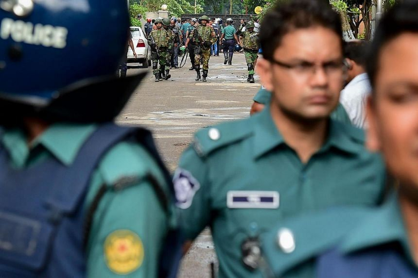 Bangladeshi soldiers and police walk along a street on July 2.