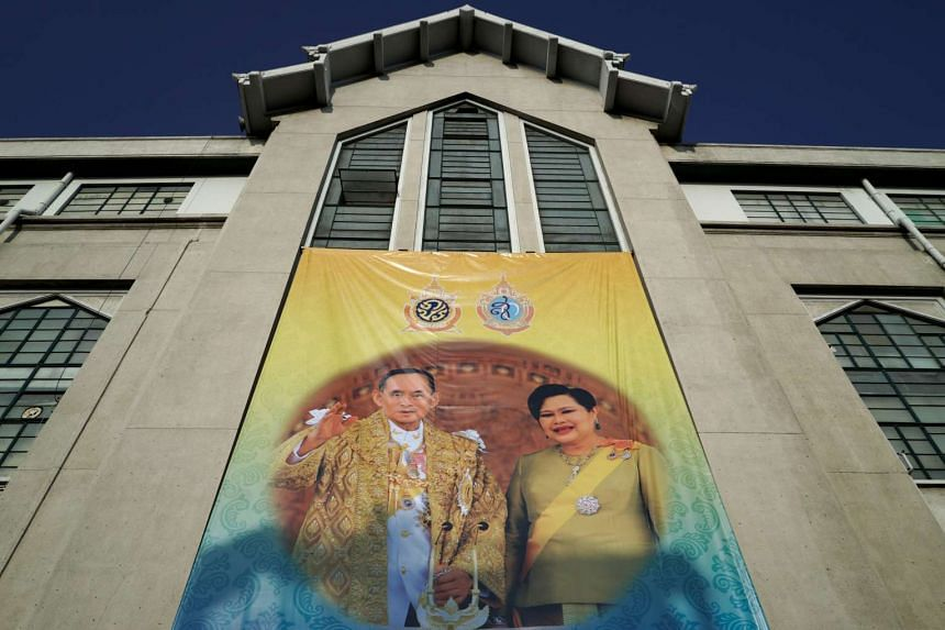 A banner depicting Thailand's King Bhumibol Adulyadej and Queen Sirikit sits on a government building in Bangkok, June 6, 2016