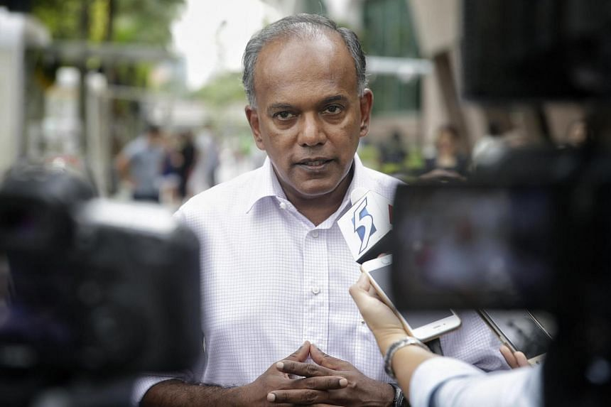 Mr K Shanmugam, Minister of Home Affairs and Law, giving a doorstop interview after visiting the Emergency Response Team on July 22.