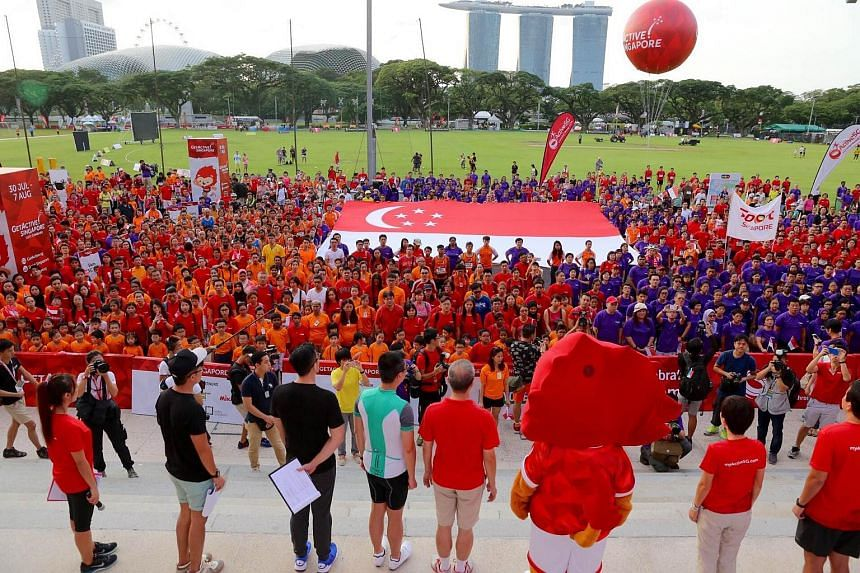 The participants singing the National Anthem together after the arrival of Minister for Culture, Community and Youth Grace Fu, and Minister for Communications and Information Yaacob Ibrahim.