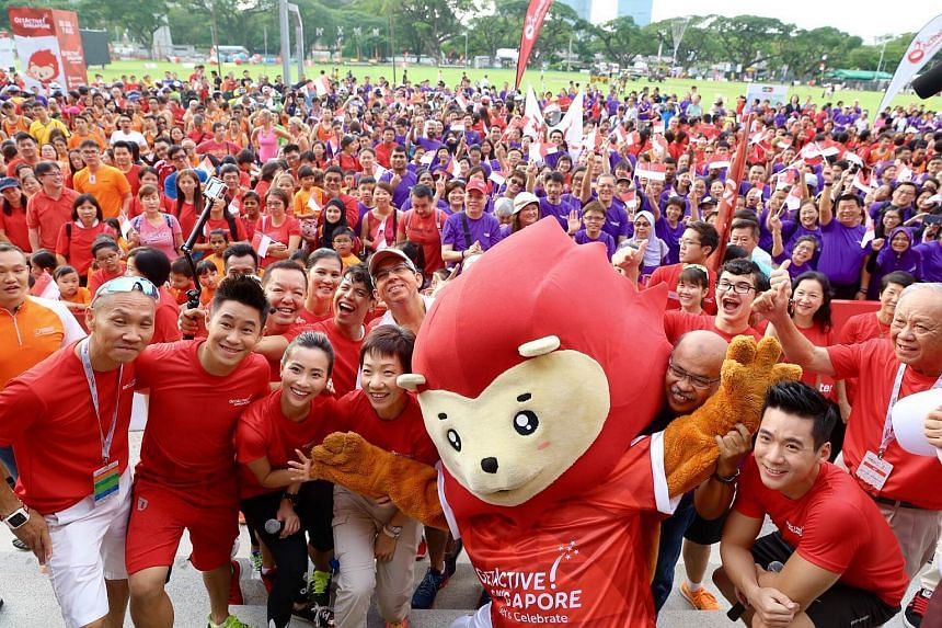 Group photo with guests, participants and Nila, Singapore's sporting mascot.