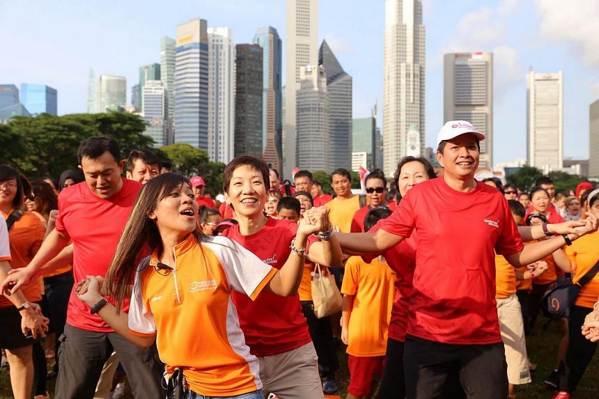 """2500 people doing the """"Friendship Dance""""in front of the Singapore Recreation Club in attempt to break the Singapore Book of Records for the largest number of people dancing. They were required to complete five minutes of non-stop dancing."""