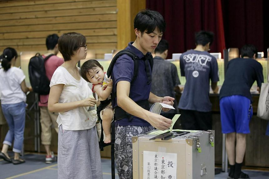 A Tokyo voter casts his ballot for Tokyo gubernatorial election at a polling station in Tokyo, Japan on July 31.