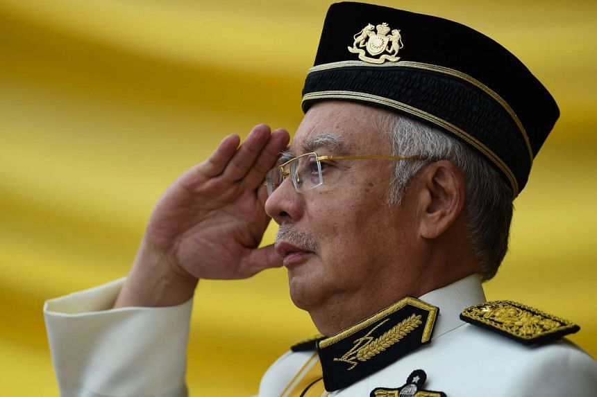 Malaysia's Prime Minister Najib Razak salutes as he arrives for the Warriors' Day Celebration in Putrajaya on July 31, 2016.