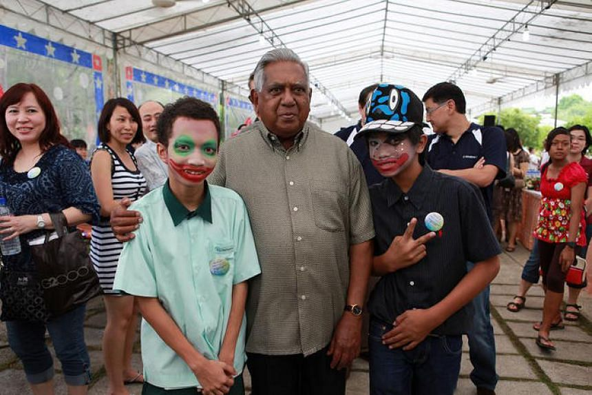 President S R Nathan and students of Grace Orchard School, which caters to children with special needs, at a concert and carnival organised by Microsoft for The 2009 President's Challenge.
